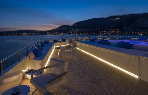 sundeck aboard luxury yacht SERENITY lights up at night