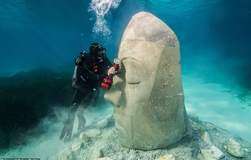 Artist Jason deCaires Taylor chiselling a sculpture for the Cannes Underwater Museum