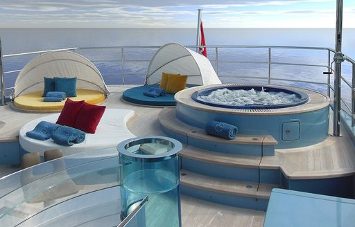 Jacuzzi and sun pads on sundeck of superyacht PHILMI