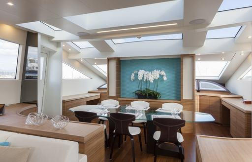 Main dining table and chairs on superyacht 55 FIFTYFIVE