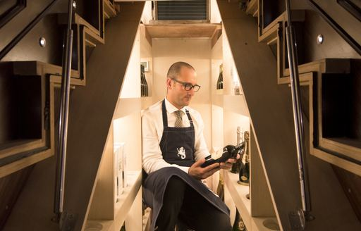 A man choose a wine onboard SY Satori