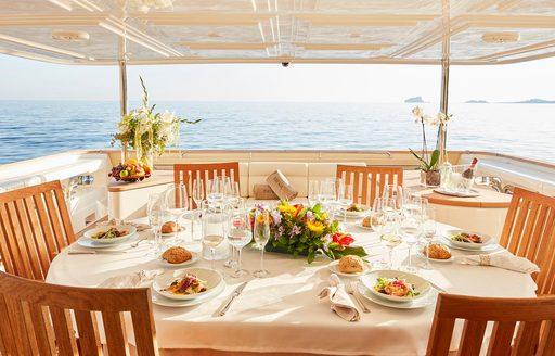 alfresco dining area set up for dinner on board superyacht DEVA