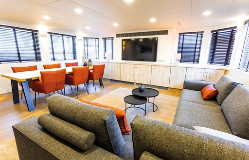 Dining area and sofa seating on board yacht JOY RIDER