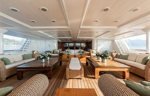 Covered dining areas on deck of superyacht Bleu De Nimes