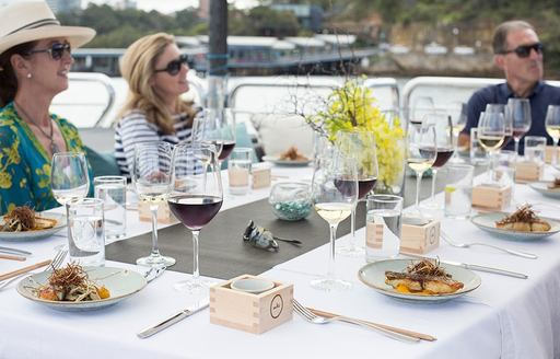 charter guests enjoy alfresco dining on charter yacht 'Ghost II'