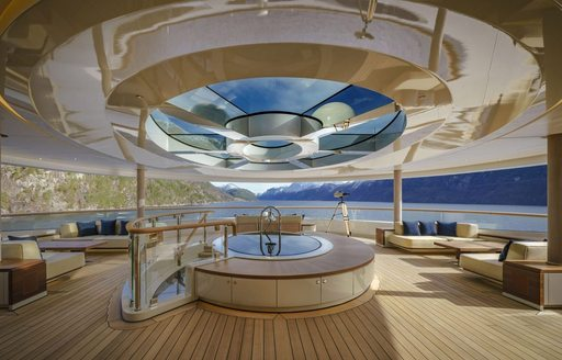 Aft deck seating area with glass skylight on board superyacht Flying Fox