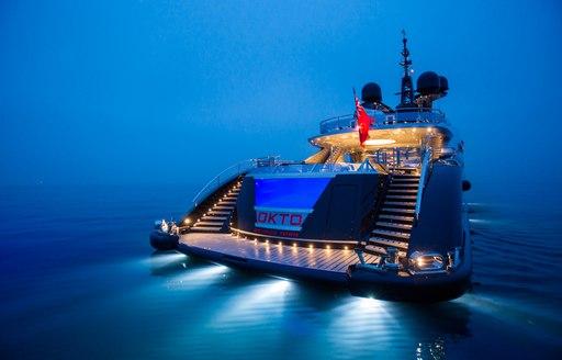 okto superyacht lit up