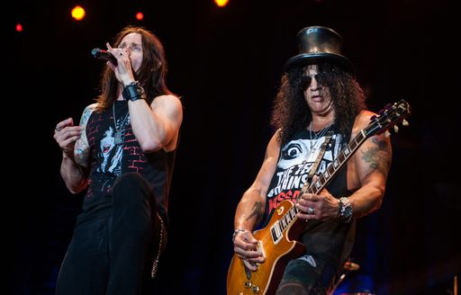 Singer and bassist of Guns N Roses performing on stage