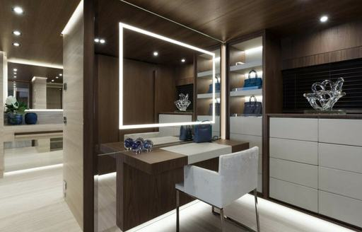 small study space on board superyacht utopia iv with discreet light panels in the mirror