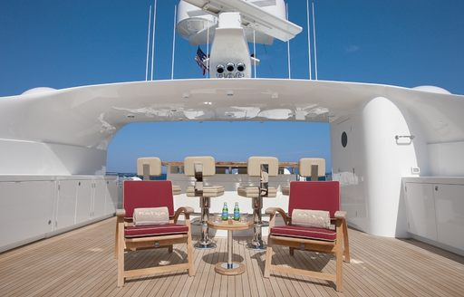 The bar and surrounding seating on the exterior of luxury yacht KATYA