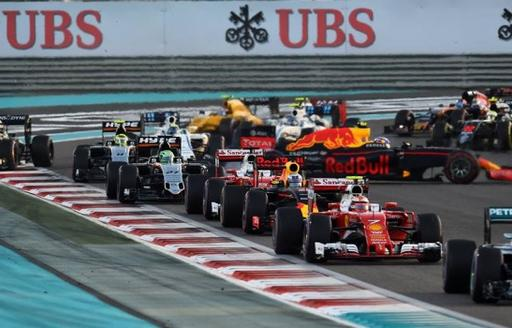 Formula 1 cars line up at the start of the Yas Marina Circuit before the Abu Dhabi Grand Prix gets underway