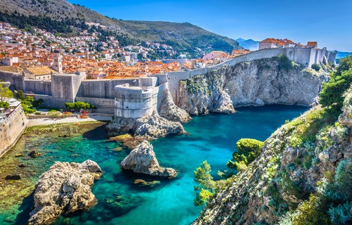 Aerial view at famous european travel destination in Croatia, Dubrovnik old town. / Selective focus