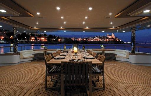 The exterior dining section of superyacht MARAYA