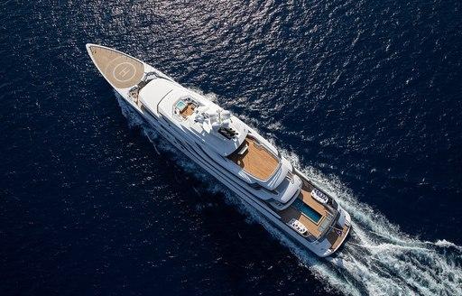 aerial view of luxury superyacht madsummer sailing through deep ocean towards holiday destination