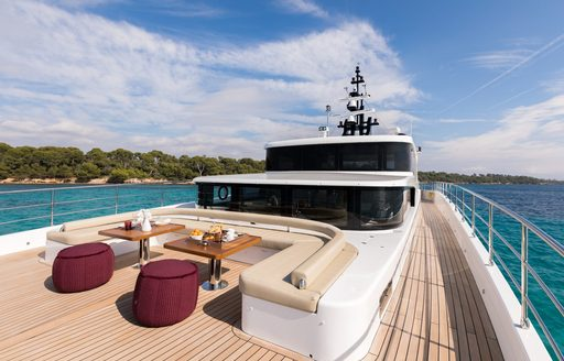 large foredeck with seating area on board luxury yacht ONEWORLD