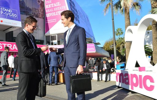 making contacts at MIPIM outside the Palais des Festival