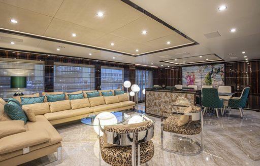 main salon on luxury yacht happy me, with soft furnishings and large sofas