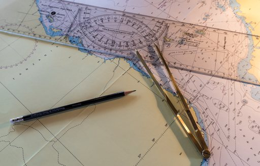 maps and charts on board motor yacht over the rainbow