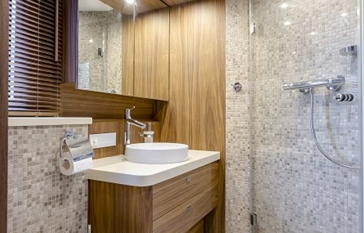 en suite bathroom forming part of the master suite on board luxury yacht Timeless