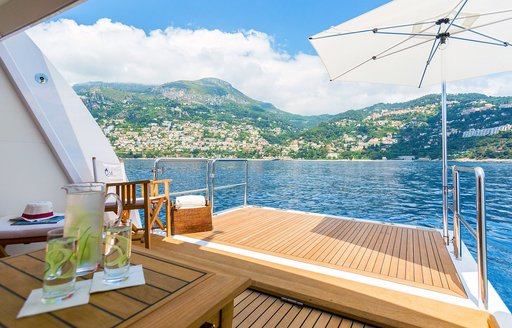 fold-down swim platform creates an alluring beach club aboard motor yacht AIR