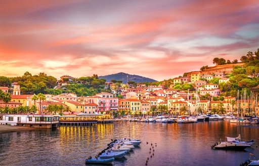 sunset over little island in italy
