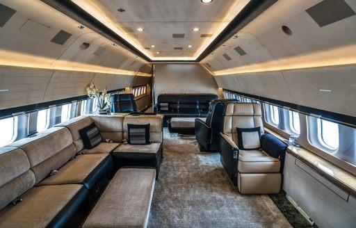 plush interiors of private jet plane