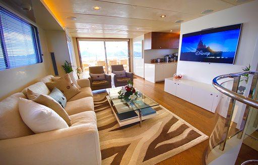 Sofa facing large flatscreen TV on superyacht LIONSHARE