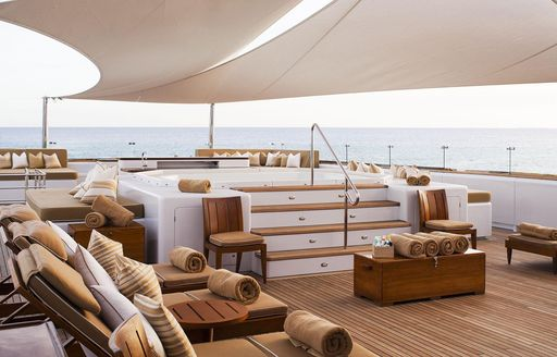 Superyacht Suri sun deck with jacuzzi and loungers