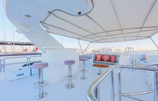 wet bar with Jacuzzi beyond on board charter yacht DXB