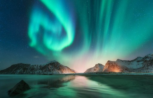 northern lights above the ocean