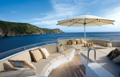 Charter yacht UTOPIA's sundeck with sofa seating, sunpads and views over the Caribbean islands