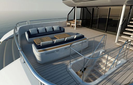 exterior decks of soaring yacht, with sofa seating and steps leading to aft decks