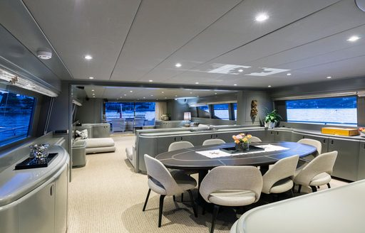 Dining area with table on Mondo Marine motor yacht TALILA
