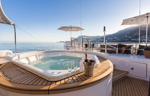Jacuzzi with champagne on the sundeck of superyacht AIR