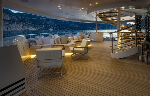 outdoor seating area at dusk on board charter yacht SERENITY