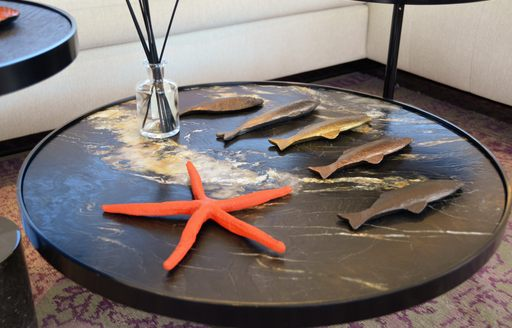 Elegant table at Cannes Yachting Festival, with starfish on table