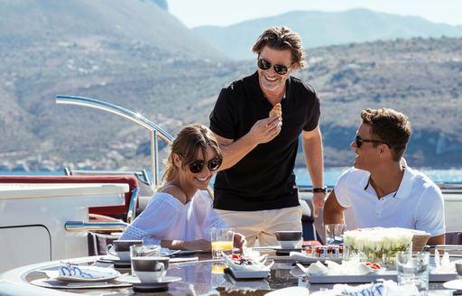 charter guest enjoys breakfast on superyacht
