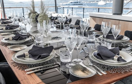 Alfresco dining table set for dinner onboard MY Severin's