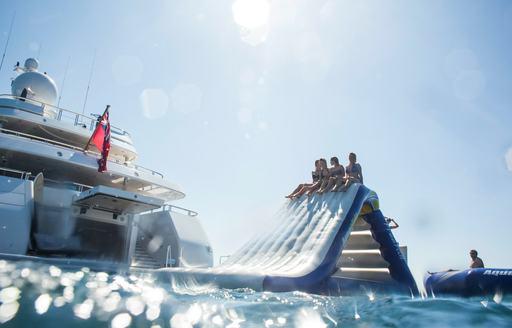 Inflatable slide on superyacht TITANIA