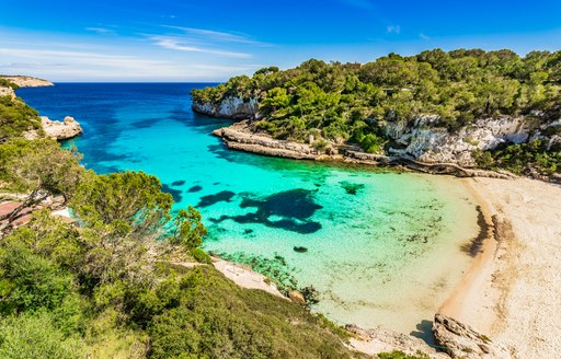 Beach in Menorca with turquoise waters and white sand