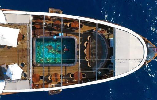 Aft deck swimming pool of superyacht Christina O