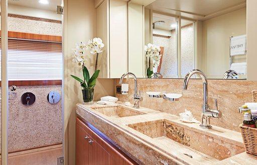 en-suite bathroom with marble and modern fixtures on board luxury yacht DEVA