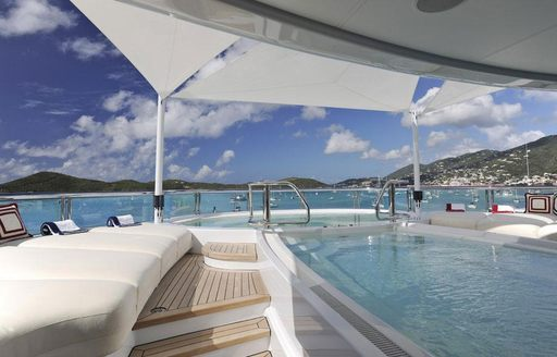 Pool on board charter yacht TV