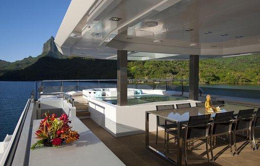 alfresco dining on sundeck of charter yacht 'Big Fish'