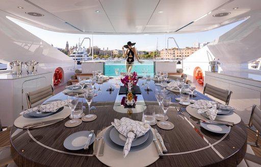 Sundeck on luxury yacht VIDA, woman in background in pool