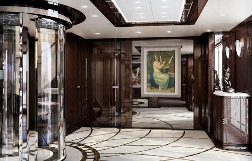 Benetti motor yacht SPECTRE main lobby, with glass lift, art deco lines on the floor and French oil painting on the wall