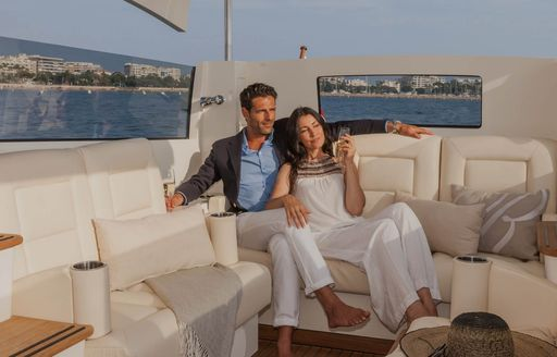 Charter guests leave their superyacht by tender and enjoy the views and some champagne