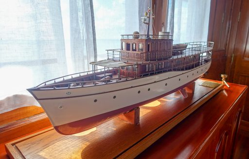 close-up image of a scale model of dickie and sons superyacht over the rainbow following a refit by Mondo Marine. Model located in main salon.