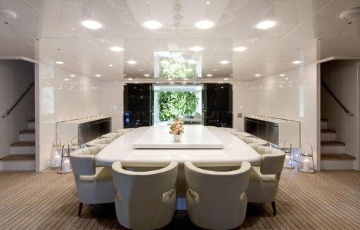 A fresh white dining table on the exterior of superyacht VICKY