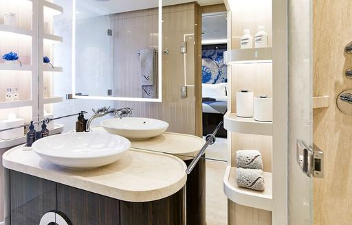 en suite bathroom on charter yacht soaring, with cream coloured sink and shelves